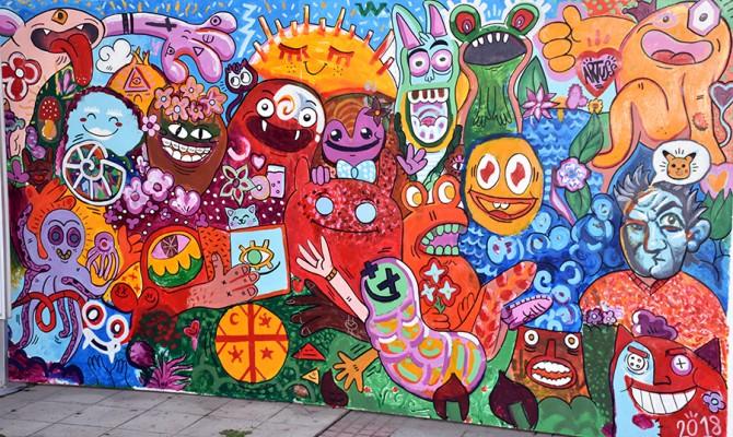 Mural de estudiantes en ARTUSS4
